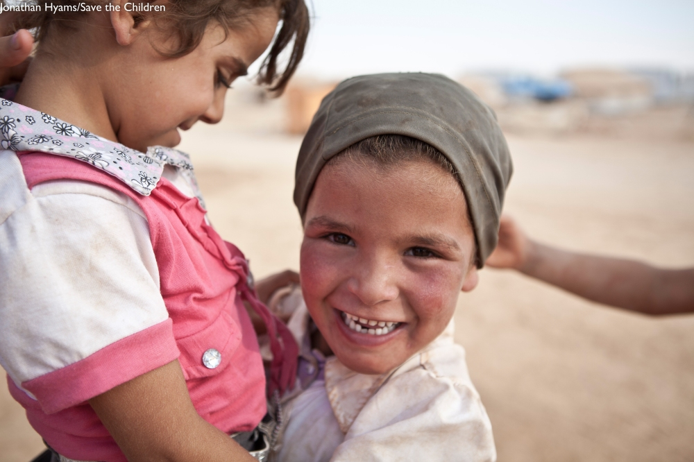 Syrian girls play together at Za'atari Refugee Camp, Jordan